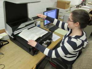 Archives staff using the Zeutschel  scanner.