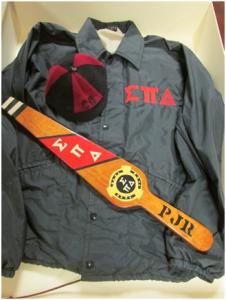 Freshmen dink and Sigma Pi Delta Fraternity jacket and paddle (Courtesy of Paul Rybcvzyk, BA 1972, MA 1977)