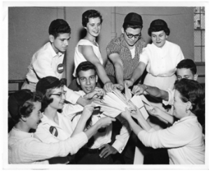 Freshmen during Registration, 1950s – Notice the small caps and name badges.