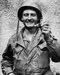 Fr. Kapaun seen holding a bullet-damaged pipe during the Korean War (Courtesy: US Army)