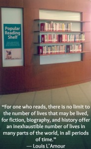 """Image of popular reading shelf with text: """"For one who reads, there is no limit to the number of lives that may be lived, for fiction, biography, and history offer an inexhaustible number of lives in many parts of the world, in all periods of time."""" ― Louis L'Amour"""