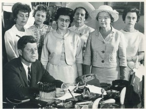 Kennedy signing the Equal Pay Act of 1963 while Margaret Mealy (second from right), the head of the National Council of Catholic Women, looks on, June 1963. The bill abolished wage disparity based on sex. Mealy received one of the pens Kennedy used to sign the bill.)