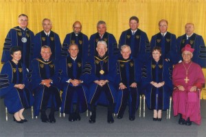 Who do you notice when you first look at this photo? Archives staff didn't even see former President of the U.S., George Bush, when they first looked at this shot. Rather, they noticed their favorite researcher and historian of the African-American experience, Cyprian Davis, third in, the top row. Here he is pictured receiving an honorary doctor of laws degree in 2001 at Notre Dame University.