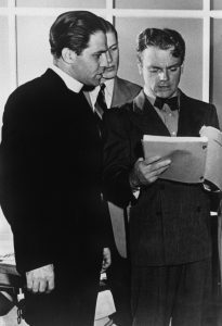 In 1939 the musical Yankee Doodle Boy was first performed at CUA. Based on the life of songwriter and entertainer George M. Cohan, the production was made into a film, Yankee Doodle Dandy, starring James Cagney, in 1942. Here, Father Hartke studies a script of Yankee Doodle Boy with Cagney in 1941.