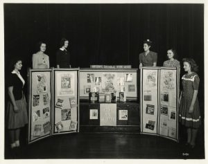 """St. Rose students show off their """"Books are Weapons"""" display."""