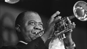 Louis Armstrong playing the trumpet. Image from NPR's 'Jazz Profiles.'